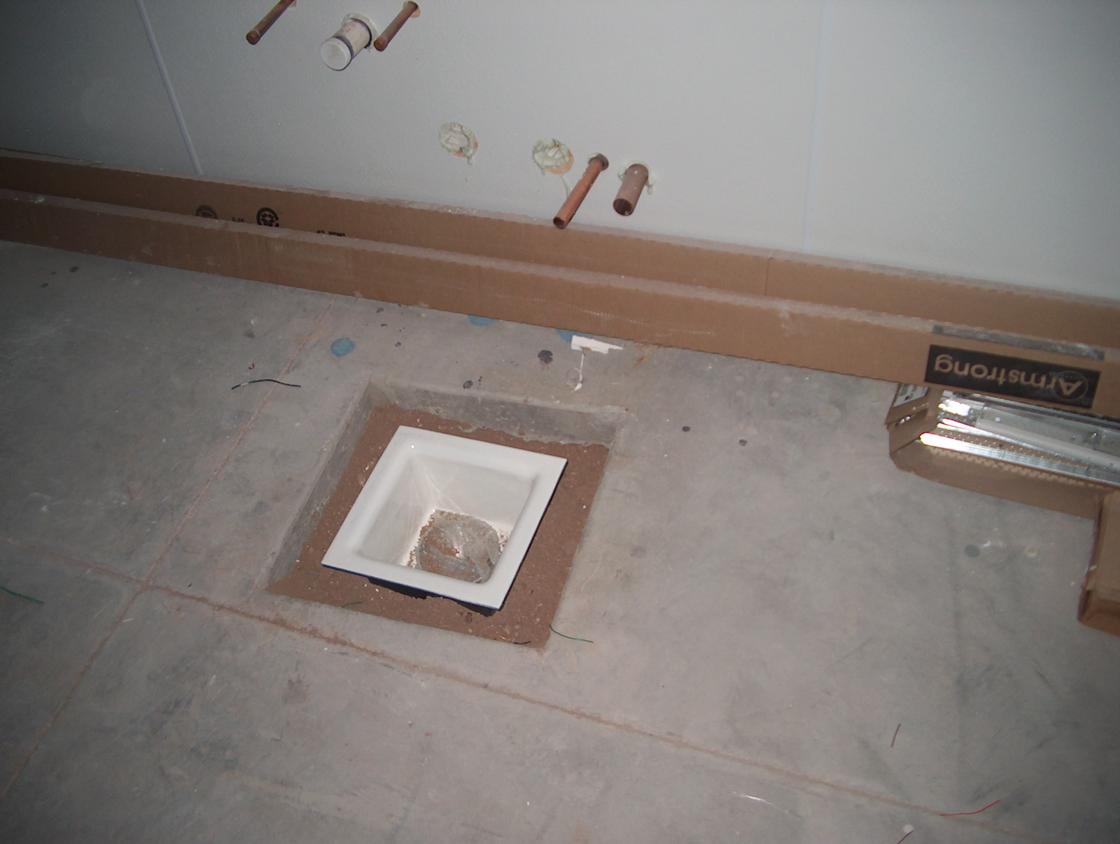 one of a number of floor sinks- this ones for the ice machine